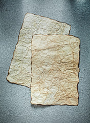 Aged sheets of paper on grey background