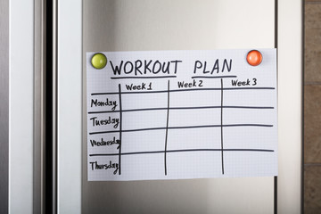 Workout Plan Paper Attached With Magnetic Thumbtacks