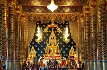 Golden buddha statue in main hall of  Wat Nimit Vipassana, temple at dan sai, Loei province, Thailand