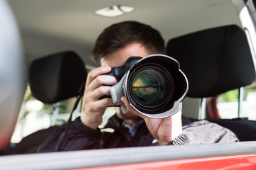 Private Detective Photographing With Slr Camera