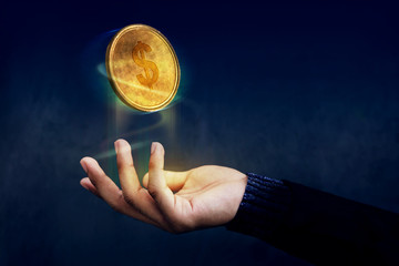Financial or Profit as Easy Concept, Golden Money Coin float over Magician hand like a Magic, Dark light