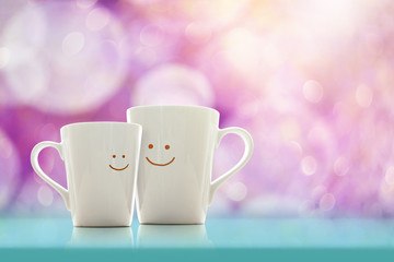 Happy Lover Coffee Cup with smiley face, Happiness and Romantic Love moment Concept, Soft Pink bokeh as background