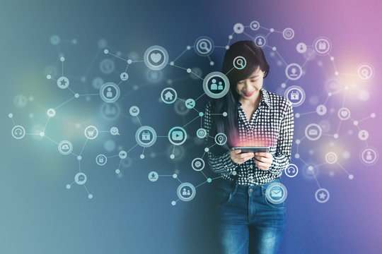 Communication Technology on daily life via Smart Phone Concept, Social media or Network system present over Soft focus of Happy Smiley face Woman standing and enjoying with them in Colorful filter