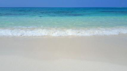 P00590 Maldives beautiful white sandy beach background on sunny tropical paradise island with aqua blue sky sea water ocean 4k