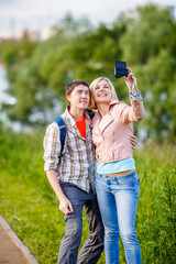 Couple taking a selfie on camera