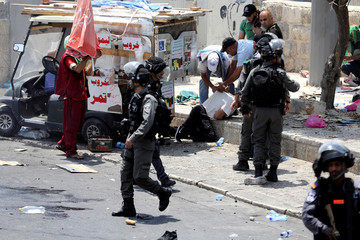 Palestinians clash with Israeli forces after Friday prayer on a street outside Jerusalem's Old city