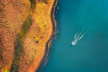 Fototapeta Aerial view of speedboat on Lake Argyle, Western Australia