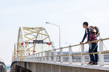 Male tourists enjoy the bridge.