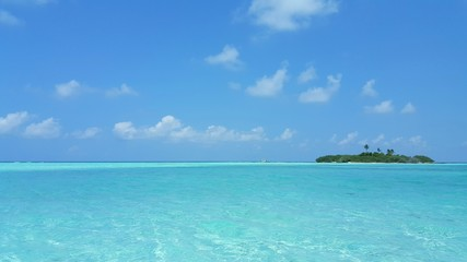 P00280 Maldives beautiful white sandy beach background on sunny tropical paradise island with aqua blue sky sea water ocean 4k