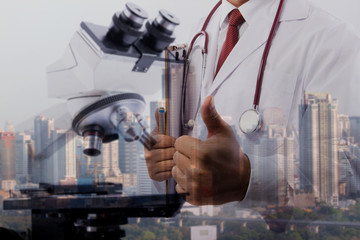 Double exposure doctor taking notes. doctor concept light,chemical element in laboratory