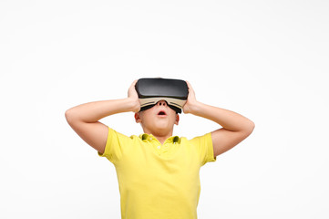 Excited kid in VR glasses