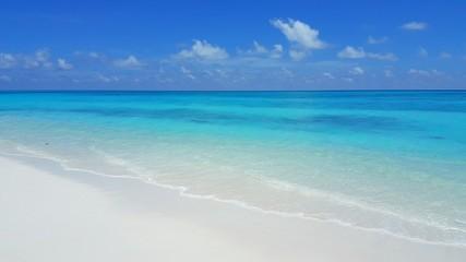 P00405 Maldives beautiful white sandy beach background on sunny tropical paradise island with aqua blue sky sea water ocean 4k