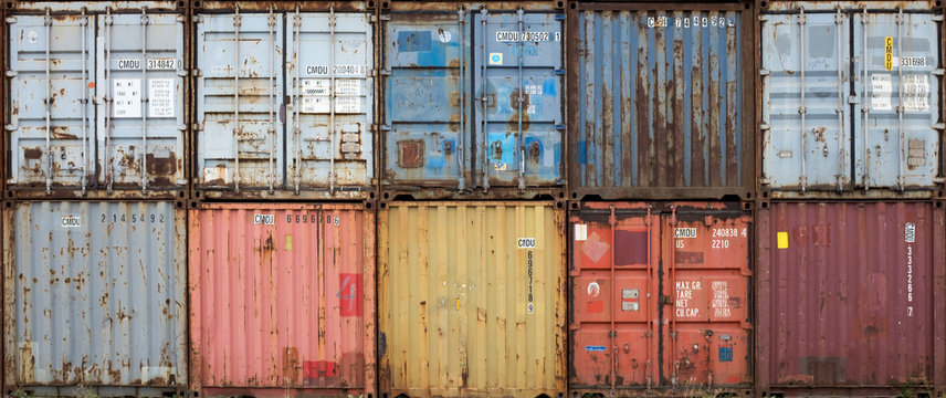 Stack of colourful and rusty containers in the port of Antwerp