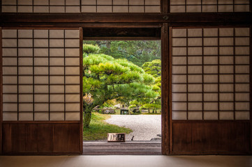 Japanese garden seen through sliding door.