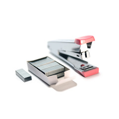 Stapler and refilled with staples isolate on white background