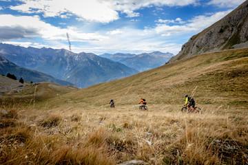 3 mountain bikes descending fast in the Alps