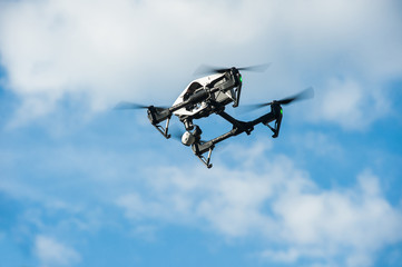 Drone in sky.Selective focus/Drone with camera flies in sky on clouds background