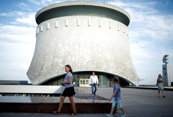 People walk at the panoramic museum of the Battle of Stalingrad in Volgograd