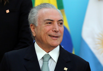 Brazil's President Michel Temer smiles before the official photo at the Mercosur trade bloc summit in Mendoza