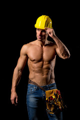 sexy fit shirtless worker with saw and tools