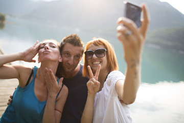 Friends Take Picture with Mobile Phone