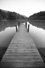 Dock on a Lake with Reflective Surface and Dramatic Perspective