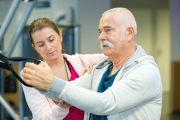 sports coach guiding senior man