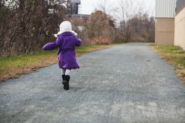 Girl runs down path