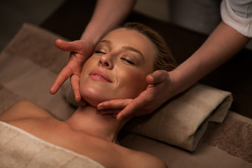 Woman receiving a face massage at spa