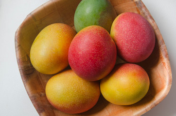 Mangoes in bowl. High angle view.