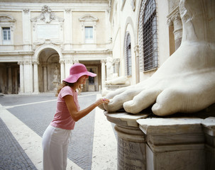 Female tourist looking at various statues. Rome. Italy