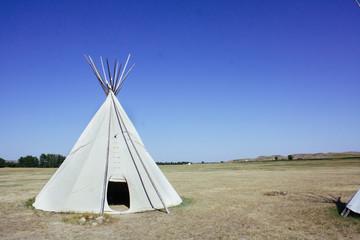 single teepee in field