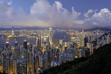 China, Hong Kong, Victoria Peak. View over Hong Kong from Victoria Peak. The illuminated skyline of Central sits below The Peak