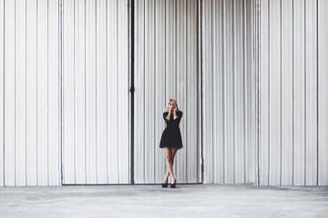Model posing in urban surroundings.