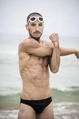 Athlete stretching before a swim