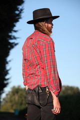 Portrait Of A Hipster Male On A Farm