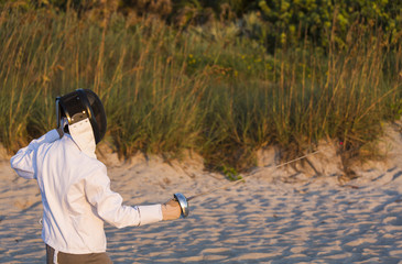 Fencer Practicing on the Beach at Sunrise