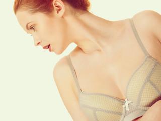 Attractive slim woman in grey matching underwear