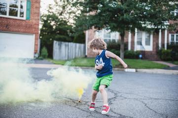 Young Boy Jumping Smoke Bombs