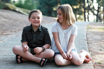 Young girl smiling looking at laughing boy