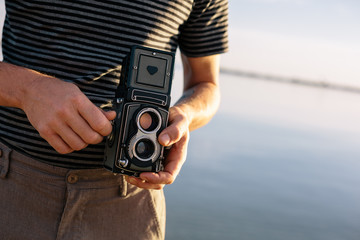 Man holding an old camera