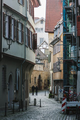 Construction on the side of a building on a narrow cobblestone street, Esslingen, Germany, Baden-W��_��___r
