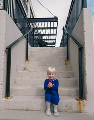 happy little girl on stairs