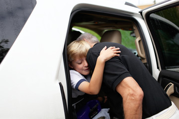 boy hugs grandfather goodbye