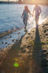 Couple walking at the waters edge