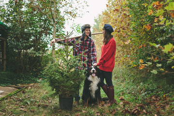 Couple and dog Bring Pine Tree