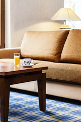 Drinking orange juice and coffee in luxury hotel interior