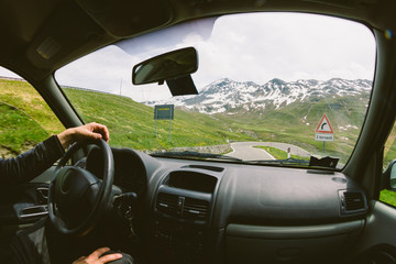 Driving a car on a mountain road