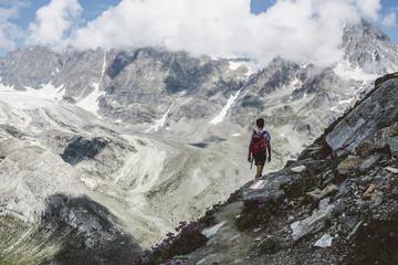 Hiker walking in mountain