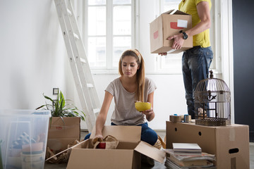 Couple Unpacking After Moving In
